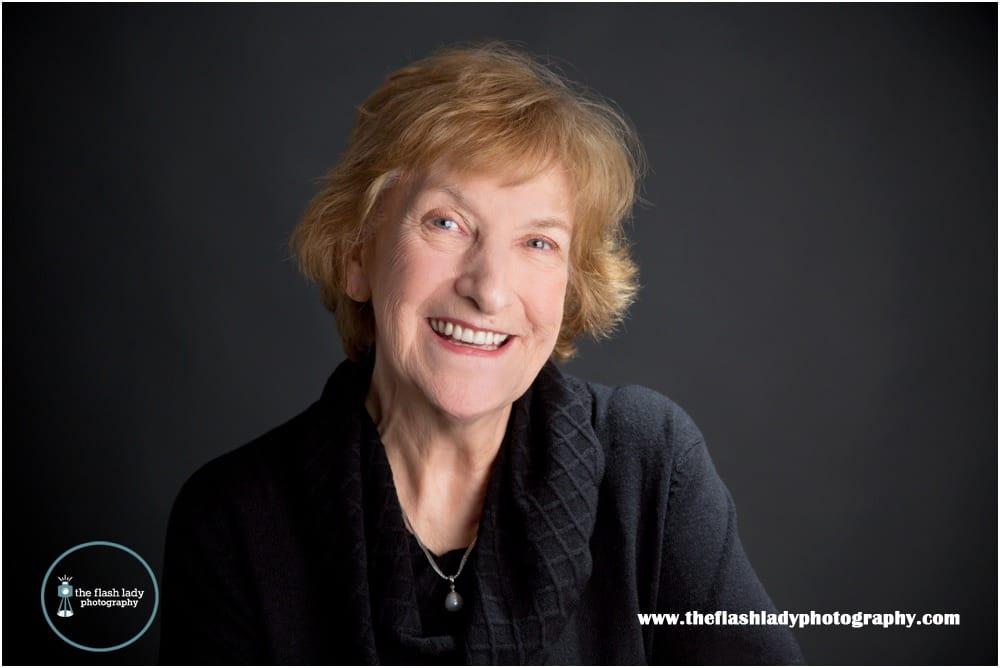 Professional headshots of Susan Huggans, Connecticut storyteller at The Flash Lady Photography studio.