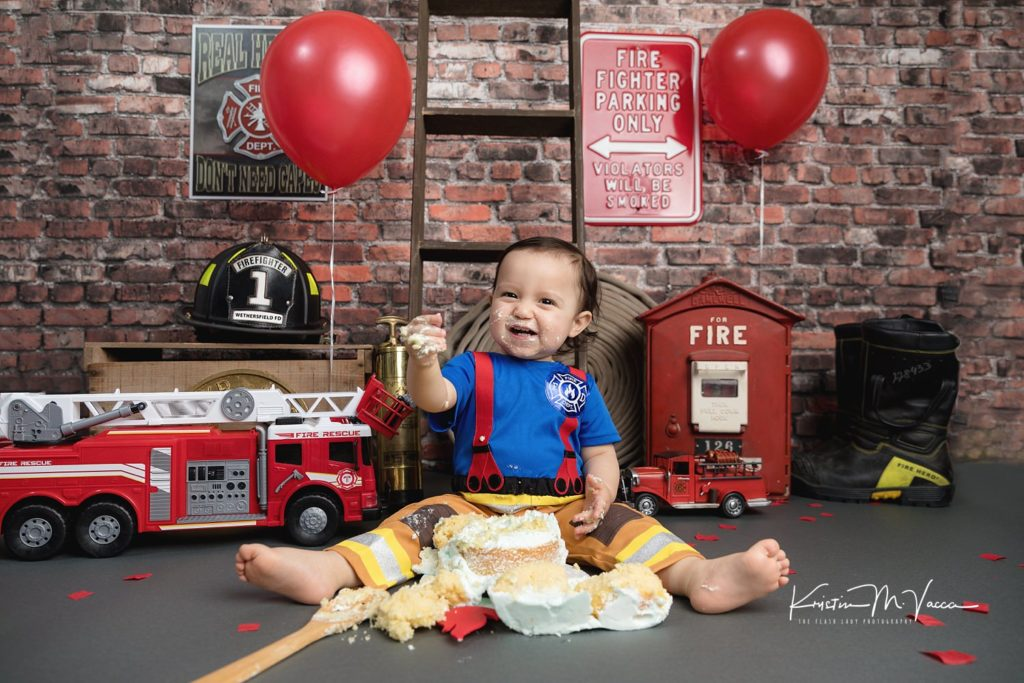 Images from our firefighter cake smash with Aiden by Wethersfield, CT photographer The Flash Lady Photography