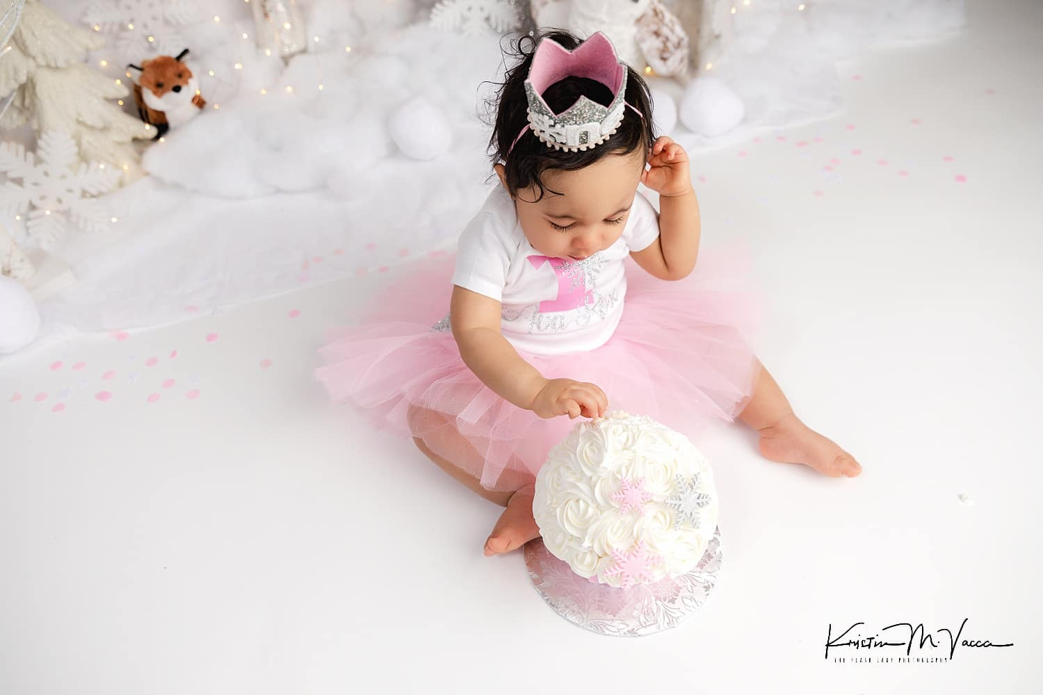 Photos from Ava's winter onederland cake smash photoshoot by West Hartford, CT photographer The Flash Lady Photography