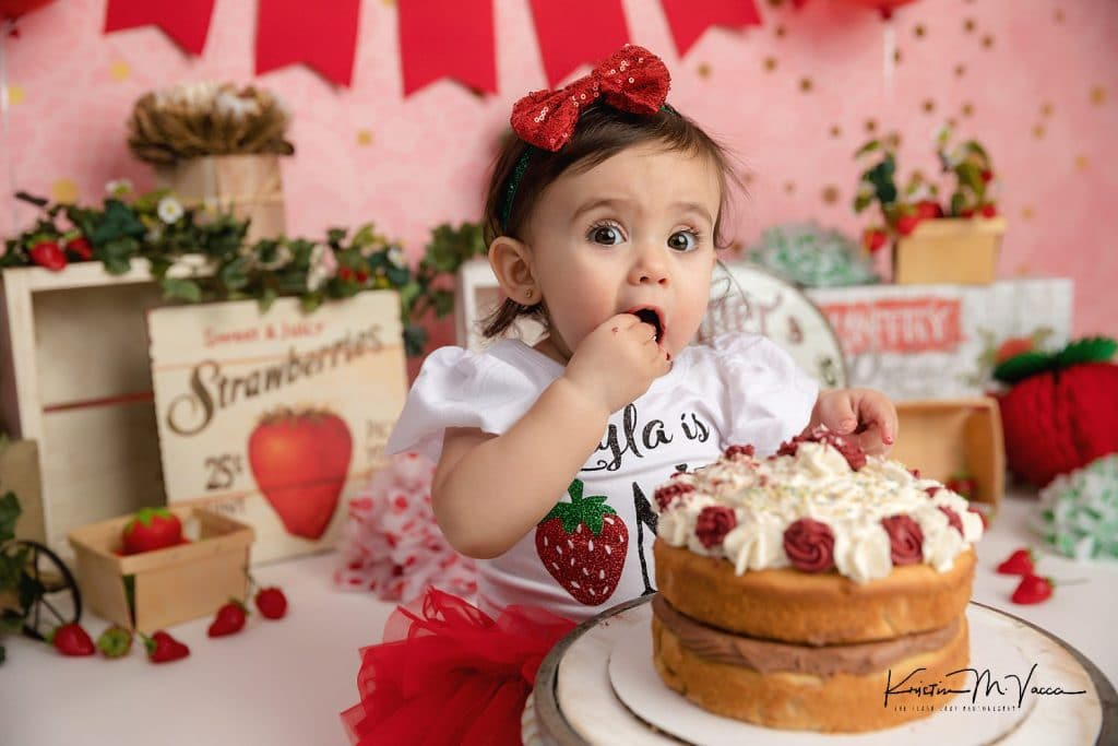 Photos from Layla's strawberry 1st birthday cake smash by Middletown, CT photographer The Flash Lady Photography
