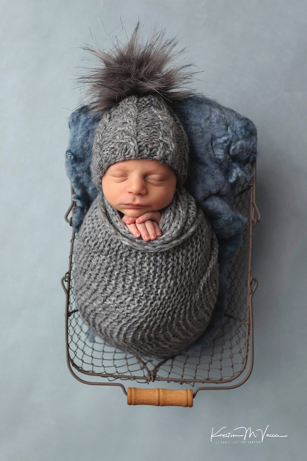 Photos from our blue and gray newborn photoshoot with baby Bennett by West Hartford photographer The Flash Lady Photography