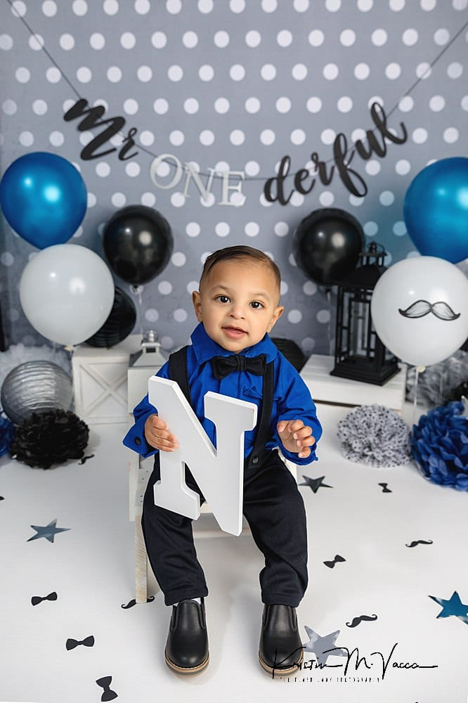 Dressy custom first birthday cake smash theme in blue, black, silver, and white colors