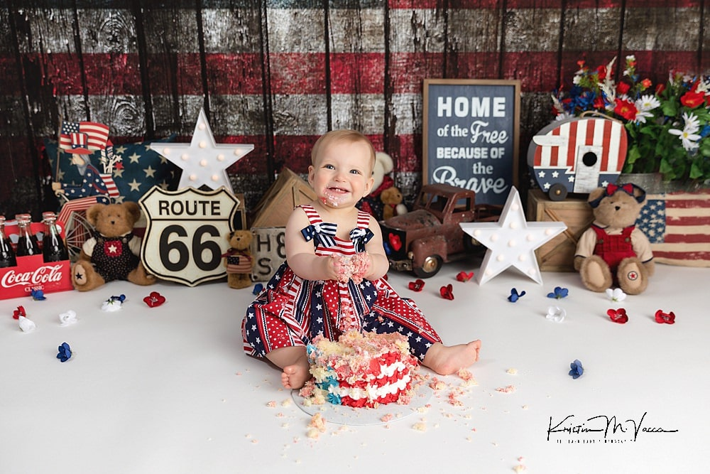 4th of July cake smash of baby Ella by The Flash Lady Photography