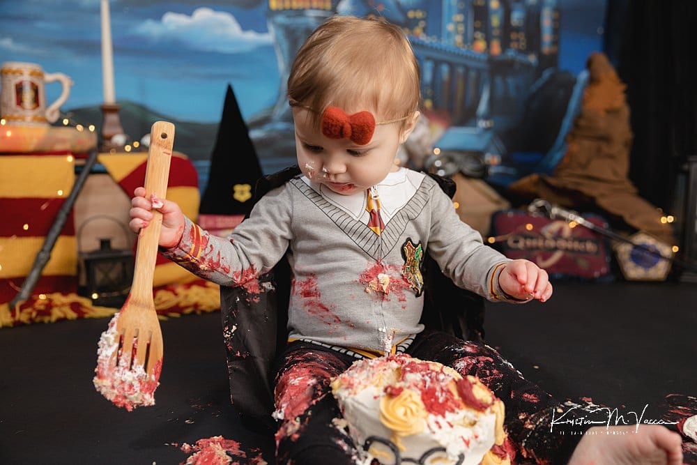 Harry Potter cake smash with baby Noelle by The Flash Lady Photography