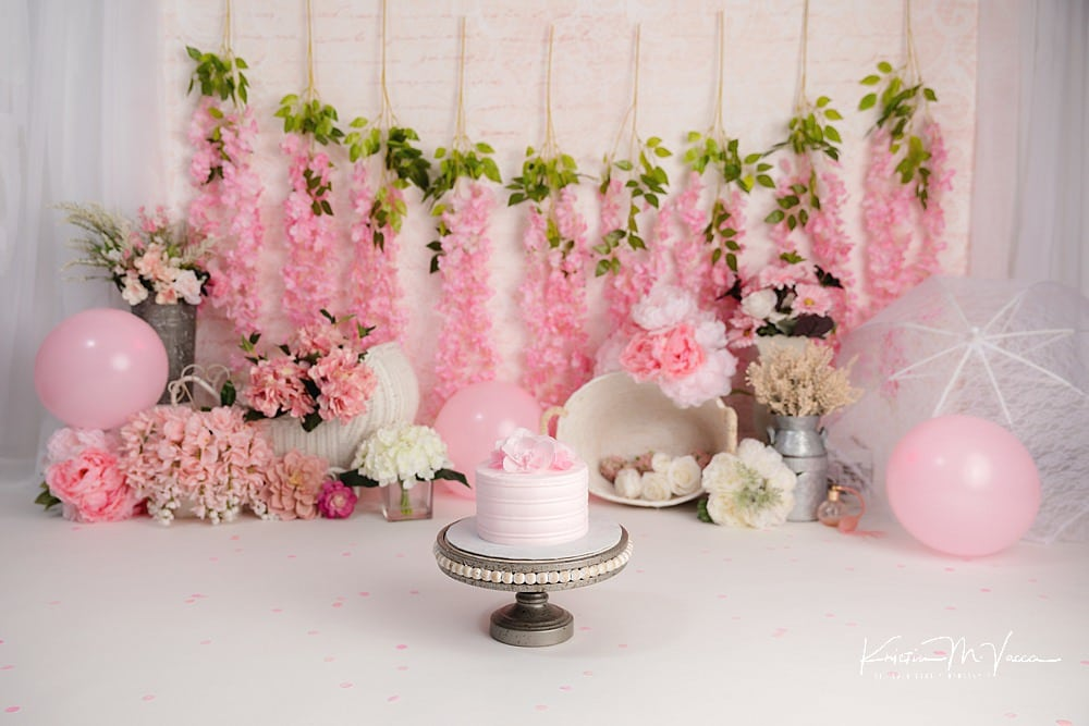 Pink floral cake smash by The Flash Lady Photography