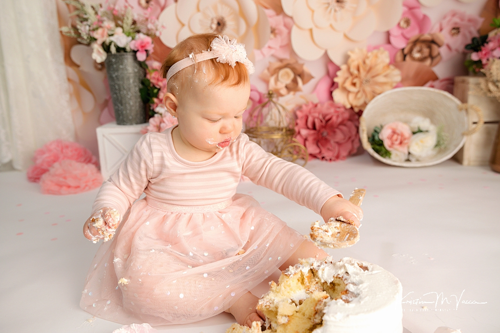 Peachy pink floral cake smash by The Flash Lady Photography.