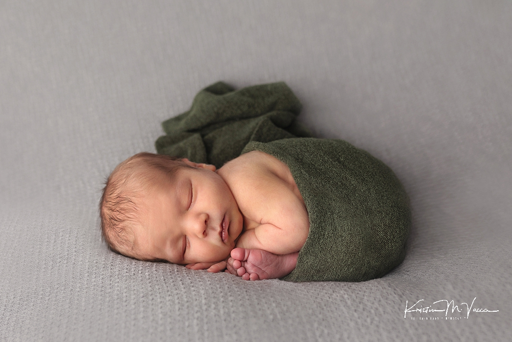 Blue & green newborn photos by The Flash Lady Photography.