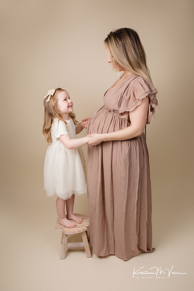 Studio family maternity photos by The Flash Lady Photography.