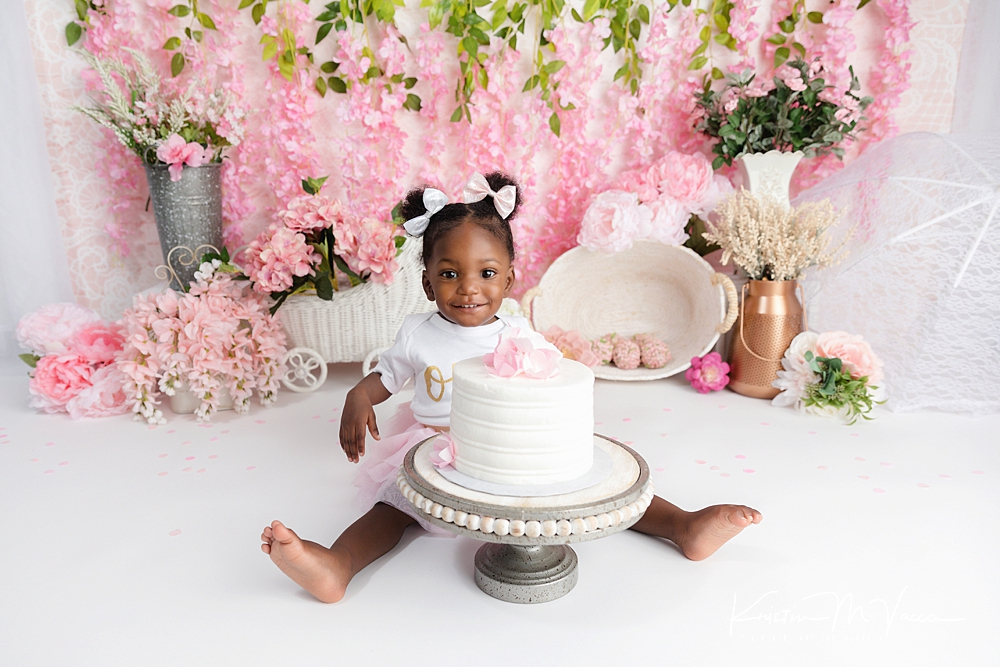 Pink floral smash of cake by The Flash Lady Photography